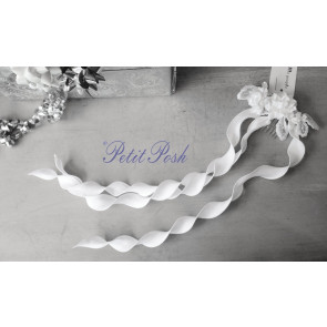 Little People 5256 White floral headdress with pearl centres on comb & long curls of satin streamers